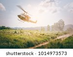 military helicopter flying in... | Shutterstock . vector #1014973573