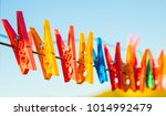 Stock photo plastic clothes pins laundry hook colorful pegs red yellow green orange blue sky outside 1014992479