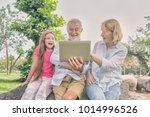 the family is happily sharing a ... | Shutterstock . vector #1014996526