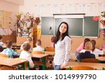 teacher starts the lesson | Shutterstock . vector #1014999790