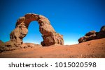 Arch Rock formation aka Arch of Africa or Arch of Algeria with moon at Tamezguida in Tassili nAjjer national park, Algeria