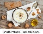 creamy cauliflower soup in a... | Shutterstock . vector #1015035328