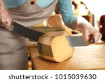 young woman cutting delicious... | Shutterstock . vector #1015039630