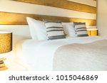 pillow on bed decoration in... | Shutterstock . vector #1015046869