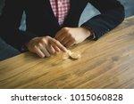 businesswoman holding bitcoin ... | Shutterstock . vector #1015060828