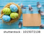 painted easter eggs in the nest ... | Shutterstock . vector #1015072138