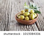green olives on wooden board | Shutterstock . vector #1015084336