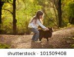 little girl walking the dog | Shutterstock . vector #101509408
