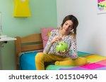 teenage girl saving money in... | Shutterstock . vector #1015104904