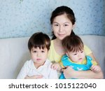 happy smiling woman with two... | Shutterstock . vector #1015122040
