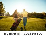 rear view of a young couple... | Shutterstock . vector #1015145500