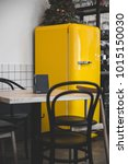 bright retro yellow fridge in...   Shutterstock . vector #1015150030