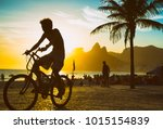 silhouette of a cyclist passing ... | Shutterstock . vector #1015154839
