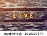 letters made of cookies love is ... | Shutterstock . vector #1015203574