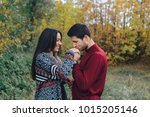 enamoured couple in the autumn... | Shutterstock . vector #1015205146