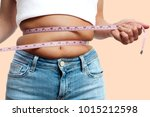overweight woman with tape... | Shutterstock . vector #1015212598