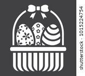 easter eggs in basket glyph... | Shutterstock .eps vector #1015224754