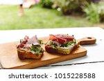 antipasti bruschetta with jamon ... | Shutterstock . vector #1015228588