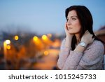 pensive woman on the balcony.... | Shutterstock . vector #1015245733