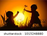 little girl gives the baby a... | Shutterstock .eps vector #1015248880