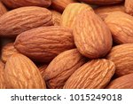 Small photo of Almond. Almonds macro. Almonds background. Almond nuts.Almond nuts texture closeup