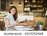woman using smart phone and... | Shutterstock . vector #1015252468