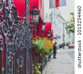 Small photo of LONDON, UNITED KINGDOM - August 2nd, 2014: flower detail of a street in Mayfair, in an affluent area of London city centre featuring the Chesterfield hotel entrance