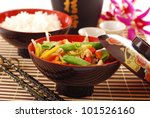 oriental dinner with bowl of deep fried chicken ,vegetables  and rice - stock photo