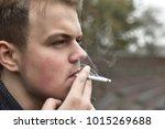 Guy Smokes A Cigarette Outside...