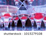 champagne glasses with cherries | Shutterstock . vector #1015279108