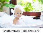 little child taking bubble bath ... | Shutterstock . vector #1015288570