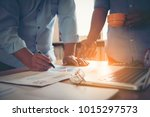 business people analyzing... | Shutterstock . vector #1015297573