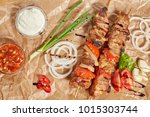 pork meat kebab with sauces and ... | Shutterstock . vector #1015303744