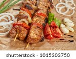 pork meat kebab with sauces and ... | Shutterstock . vector #1015303750