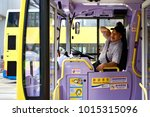 Central, Hong Kong - 8 Dec 2017: A lovely bus driver waiting passenger to get on board on the bus. - stock photo