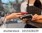 a woman pays for an account... | Shutterstock . vector #1015328239