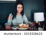 cheerful woman is about to eat. | Shutterstock . vector #1015328623