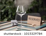 reserved table with empty glass ... | Shutterstock . vector #1015329784
