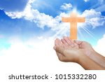 human hands pray with cross | Shutterstock . vector #1015332280