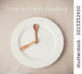 white plate with spoon and fork ... | Shutterstock . vector #1015352410