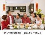 cheerful family members talking ... | Shutterstock . vector #1015374526