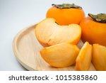 a very sweet persimmon when... | Shutterstock . vector #1015385860