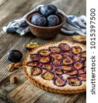 homemade plum pie on the old... | Shutterstock . vector #1015397500