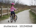 little girl riding her bicycle... | Shutterstock . vector #101540068