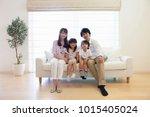 japanese family sitting on the... | Shutterstock . vector #1015405024