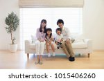 japanese family sitting on the... | Shutterstock . vector #1015406260