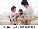 japanese parents and children... | Shutterstock . vector #1015409320