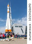 "Small photo of Russia, Samara, April 12, 2016: the celebration of the Day of Astronautics on the square named. DI. Kozlov on a spring sunny day. The monument to the rocket ""Soyuz"" and the space museum of Samara"