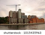 building crane and housing... | Shutterstock . vector #1015435963