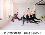 group of women doing yoga ... | Shutterstock . vector #1015436974
